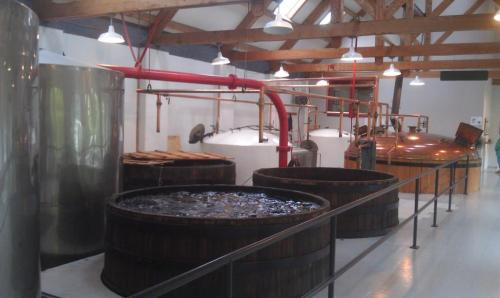Fermentation vats with the copper mash tun in the background